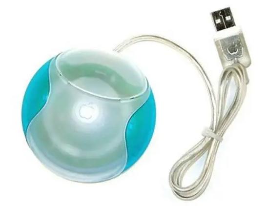 Fotografia de um mouse do iMac da década de 90, famoso mouse redondo de apenas um botão